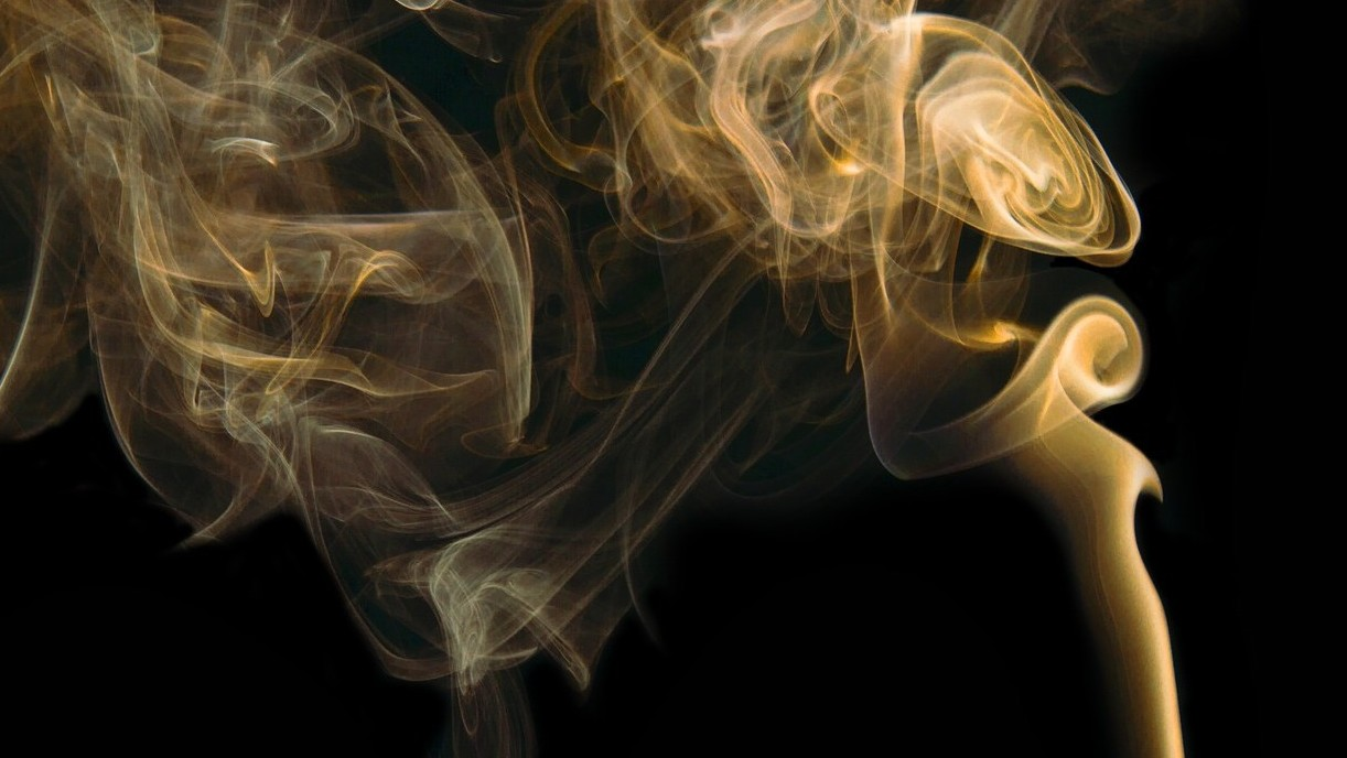 turbulence generated from smoke rising from cigarette